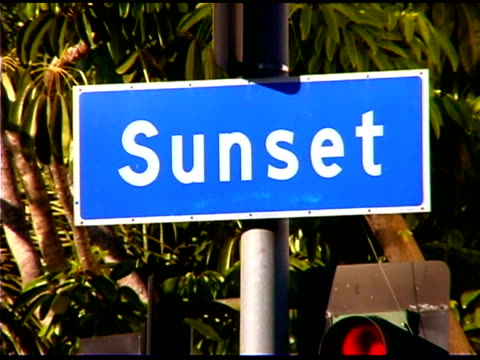 street sign of sunset boulevard in los angeles, california - sunset boulevard stock-videos und b-roll-filmmaterial