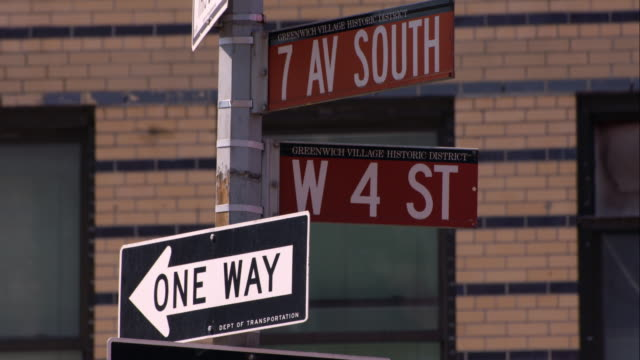 Street sign on 7th Av South and 4th St in Manhattan with a one way sign.
