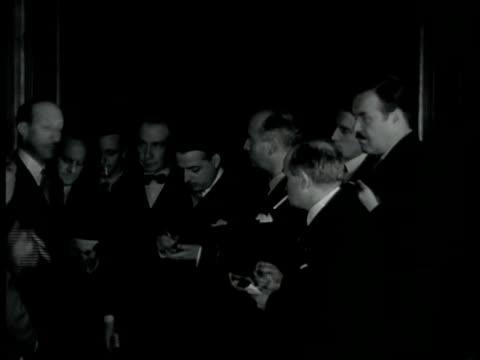 street sign 'quai d'orsay' int vs men standing taking notes. ext vs men stacking sandbags pont alexandre iii monument & grand palais bg.... - 1930 video stock e b–roll