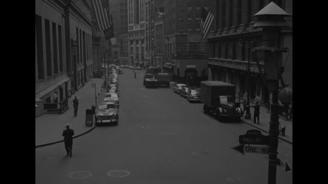 street sign wall st tilt up to air raid siren above prior to civil defense drill / empty section of wall street during civil defense drill in... - air raid siren stock videos & royalty-free footage