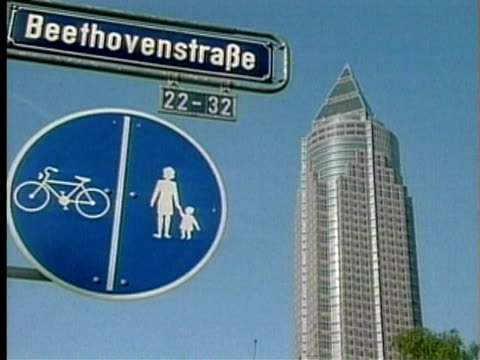 1994 MS LA Street signs against clear sky in Frankfurt with Messeturm skyscraper in background/ Frankfurt am Main, Germany/ AUDIO
