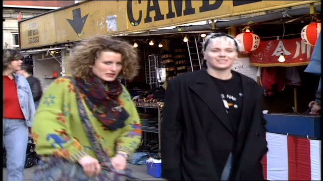 vidéos et rushes de street styles of people walking past camden market in london - punk