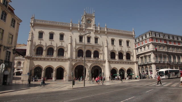 ws street traffic in front of historic building / lisbon, portugal - in front of stock videos & royalty-free footage