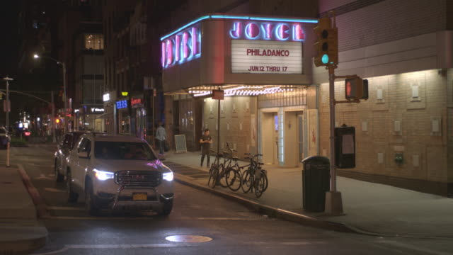 street traffic outside of the the joyce theater in manhattan new york city at night. - theater industry stock videos and b-roll footage