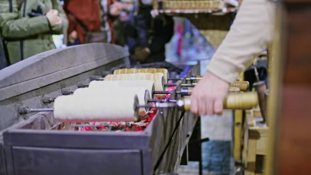 ms street vendor cooking kurtoskalacs spit cakes,budapest,hungary - budapest stock videos & royalty-free footage