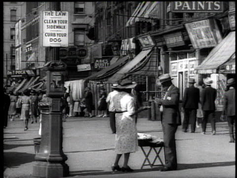 1939 ws street vendor / new york city, usa - harlem stock videos & royalty-free footage