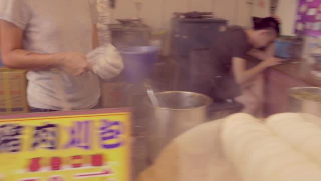 street vendor prepares rice pita sandwich in sun moon lake, taiwan - sun moon lake stock videos and b-roll footage