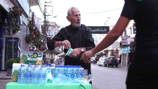 street vendor preparing his stand for customers attending the ashura commerations ashura is the 10th day of muharram commemorating the martyrdom of... - ashura muharram stock videos & royalty-free footage