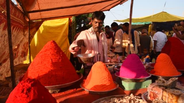 street vendor selling color. - krydda bildbanksvideor och videomaterial från bakom kulisserna