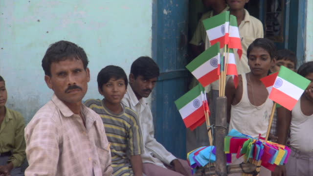 ms street vendor selling indian flags, surrounded by boys, districts of delhi, india - indian flag stock videos & royalty-free footage