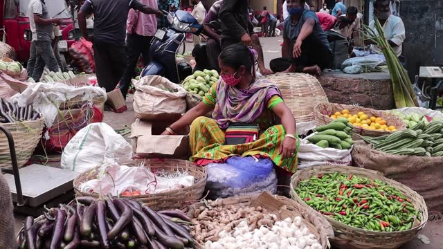street vendor selling vegetables amid covid-19 coronavirus pandemic, on may 01, 2021 in guwahati, india. authorities reported 401,993 new cases in... - selling stock videos & royalty-free footage