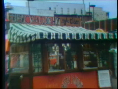 street vendor sells fresh orange juice and hot apple cider. - orange juice stock videos & royalty-free footage