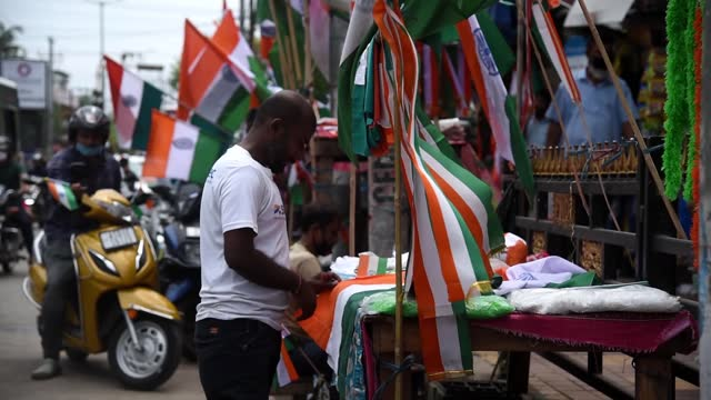 street vendor sells the tricolor indian national flag for the 75th independence day celebrations on august 15, 2021 in guwahati, india. the... - indian ethnicity stock videos & royalty-free footage