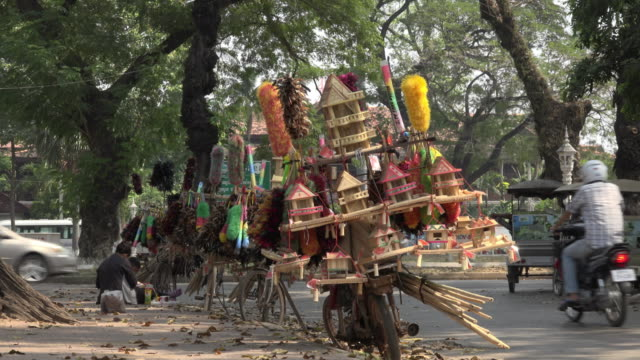 street vendor with spirit houses and household equipment on bike in siem reap town - household equipment stock videos & royalty-free footage