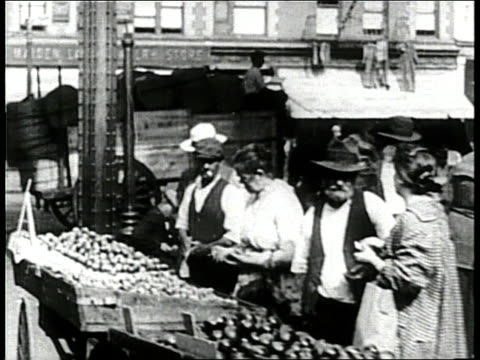 street vendors carry their wares to the shopping public by using pushcarts during the 1920s on new york's lower east side at mulberry and bayard... - push cart stock videos & royalty-free footage