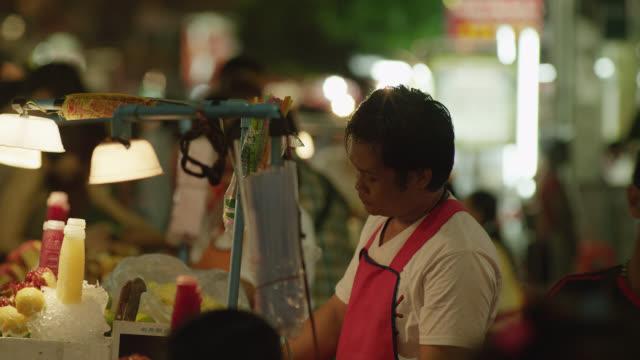 ls street vendors selling fresh fruit juice, red r3d 4k - fruit juice stock videos & royalty-free footage