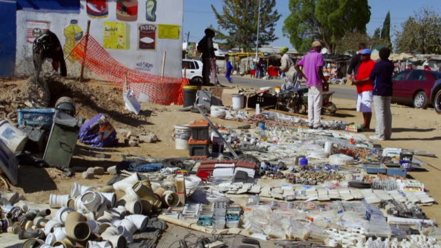 ws street vendors with items on show in town / diepsloot, south africa - ハウテング州点の映像素材/bロール