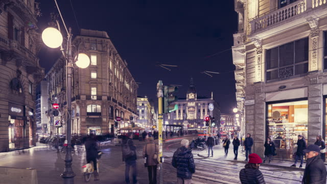 street via monte napoleone, most famous street in milan, time lapes - italian culture video stock e b–roll