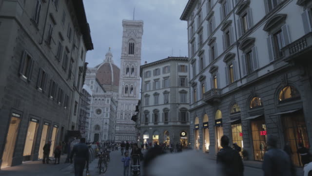 street view near campanile di giotto and basilica di santa maria del fiore at night - fiore stock videos & royalty-free footage