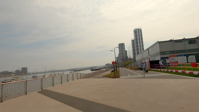 street view of london during coronavirus (covid 19) by bicycle london 104 - olympian way eastbound part 8 - 4k - waterfront stock videos & royalty-free footage