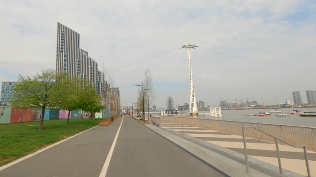 street view of london during coronavirus (covid 19) by bicycle london 105 - olympian way westbound part 1 - 4k - waterfront stock videos & royalty-free footage