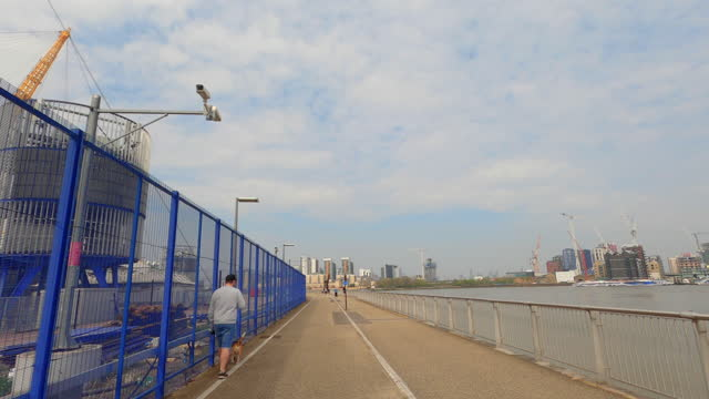 street view of london during coronavirus (covid 19) by bicycle london 106 - olympian way westbound part 2 - 4k - waterfront stock videos & royalty-free footage