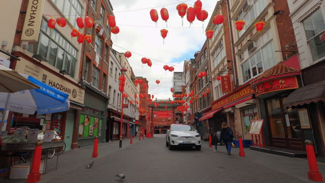 street view of london during coronavirus (covid 19) by bicycle london 69 - chinatown - 4k - lantern stock videos & royalty-free footage