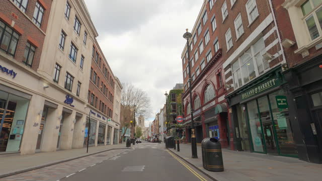 street view of london during coronavirus (covid 19) by bicycle london 71 - long acre - 4k - column stock videos & royalty-free footage