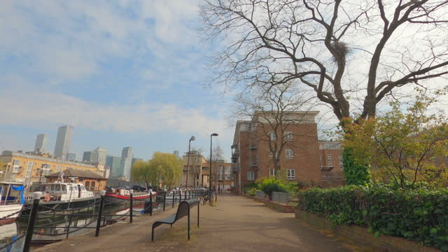 street view of london during coronavirus (covid 19) by bicycle london 85 - surrey quays part 4 - 4k - waterfront stock videos & royalty-free footage