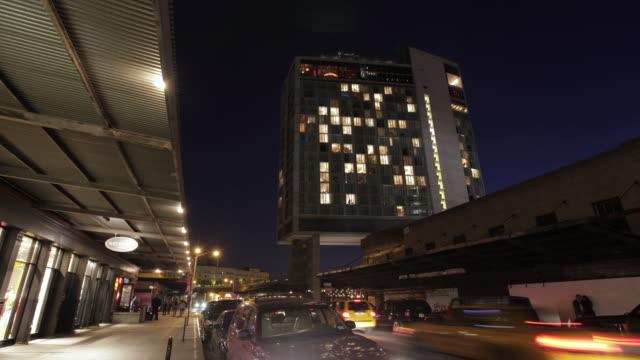 ms t/l street view of standard hotel / new york, united states - luxushotel stock-videos und b-roll-filmmaterial