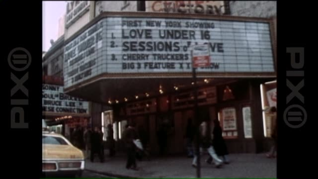 stockvideo's en b-roll-footage met street view of theatres radio city times square during the 1970s on june 07 2013 in new york new york - 1977