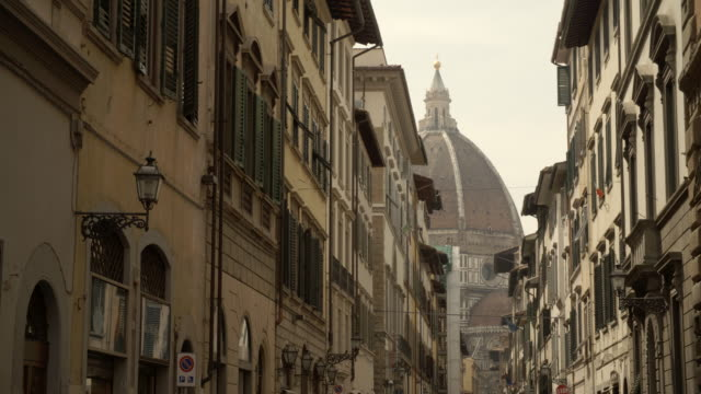 street view with piazza del duomo in the distance / florence, italy - florence italy stock videos and b-roll footage