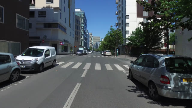 street with buildings with only three pedestrians and without traffic may 6 2020 in paris france - three people stock videos & royalty-free footage