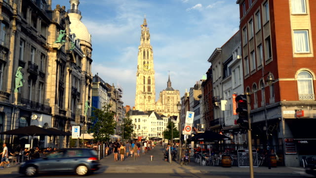 street with cathedral in antwerp - kirche stock videos and b-roll footage