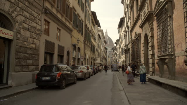 street with high buildings / florence, italy - florence italy stock videos and b-roll footage