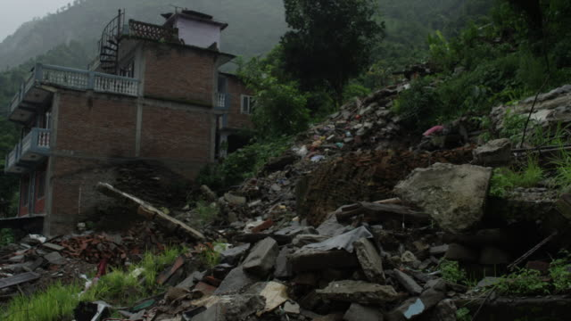 barabise, nepal - july 31, 2015: street with houses turned to rubble - rubble stock-videos und b-roll-filmmaterial