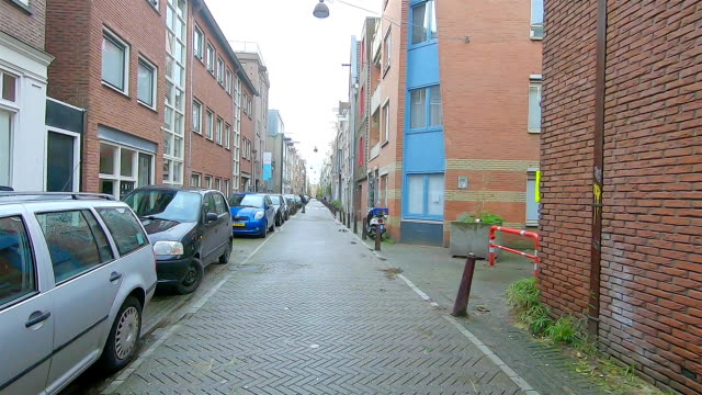street with parked cars in amsterdam. - parking stock videos & royalty-free footage