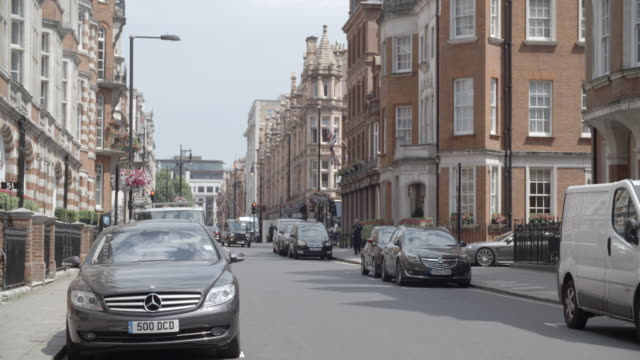 street with parked cars / london, united kingdom - parking stock videos & royalty-free footage
