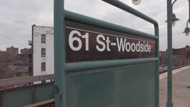 """street woodside"""" mta subway station sign in queens on the subway platform in new york city, new york on april 18, 2021. - number 6 stock videos & royalty-free footage"""