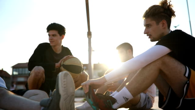 streetball men relaxing - male friendship stock videos and b-roll footage