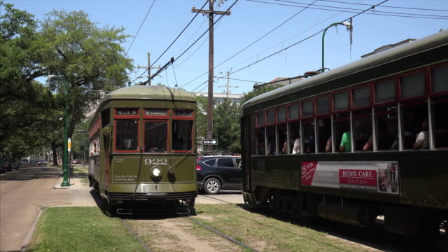 a streetcar in the garden district of new orleans, louisiana - tram stock videos & royalty-free footage