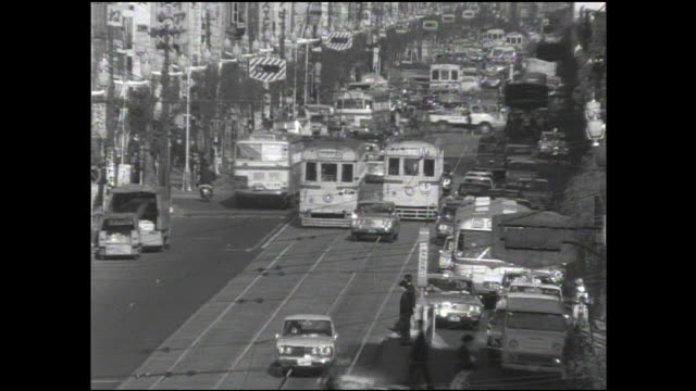 a streetcar maneuvers down a street in japan on the last day of operation for the toden ginza line. - showa period stock videos & royalty-free footage