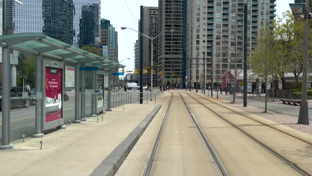 streetcar passenger point of view of harbour street by the city's waterfront on may 10 in toronto, canada. this area is a famous place and a major... - boulevard stock videos & royalty-free footage