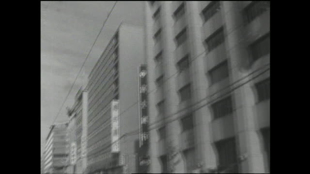 Streetcars move past stores in the Tenjin area.