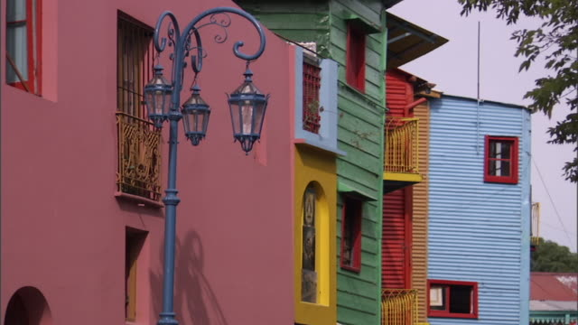 MS Streetlight in front of Brightly colored buildings in La Boca neighborhood/ Buenos Aires, Argentina