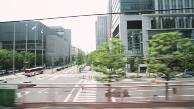 ts, ms streets and buildings in tokyo and marunouchi business districts / tokyo, japan - passenger point of view stock videos & royalty-free footage