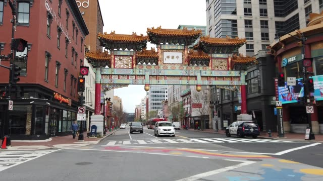 streets and plazas are empty in the chinatown neighborhood as people stay home and non-essential businesses are ordered closed due to the ongoing... - non urban scene stock-videos und b-roll-filmmaterial
