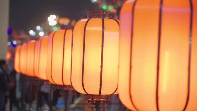 streets are decorated with lanterns to celebrate the chinese new year - electric lamp stock videos & royalty-free footage