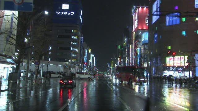 ws pov streets at night seen from driving car, tokyo, japan - car point of view stock videos & royalty-free footage