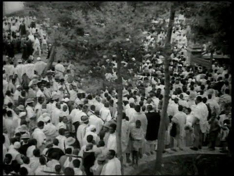 streets crowded w/ armed ethiopians in traditional clothing. ethiopians gathered walking in street. - 1935 stock videos & royalty-free footage